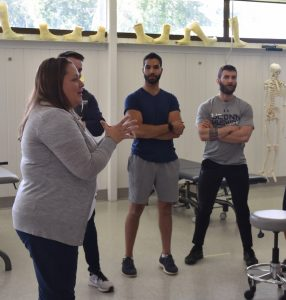 Maryclaire Cappetta instructing physical therapy students at UConn