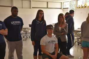students receive physical therapy instruction in doctor of physical therapy program at UConn