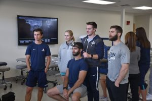 students and faculty member in kinesiology's physical therapy program