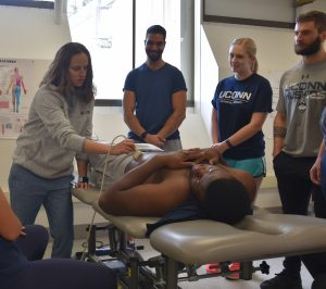 demonstrating ultrasound on a UConn student